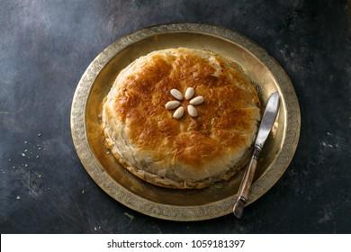 Chicken bastilla, Moroccan layered pie, top view copyspace