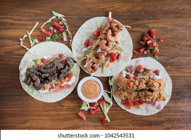 Chicken beef prawn combo tortilla wrap tacos dressed with salsa