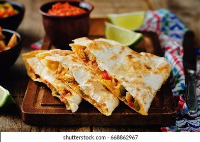 Chicken Bell pepper quesadilla on a wood background. toning. selective focus