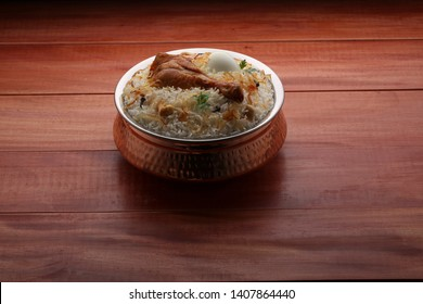 chicken biriyani- chicken dum biriyani in south indian style with wooden brown background
