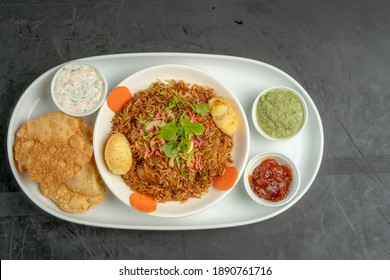 chicken biriyani plate top view on black background
