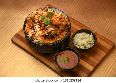 chicken biryani with gravy with spices - Shutterstock ID 1815239114