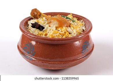 Chicken biryani in handi, Indian food, Delicious ramadan iftar meal, Pakistani spicy fried rice. Popular asian lunch, Haandi biryani.