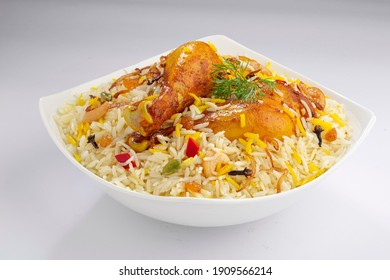 Chicken biryani , kerala style chicken dhum biriyani made using jeera rice and spices arranged in a white ceramic table ware with white background, isolated - Shutterstock ID 1909566214