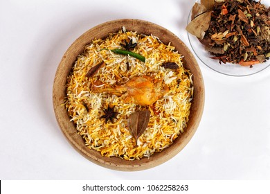 Chicken biryani on white background, Spicy indian handi biryani.