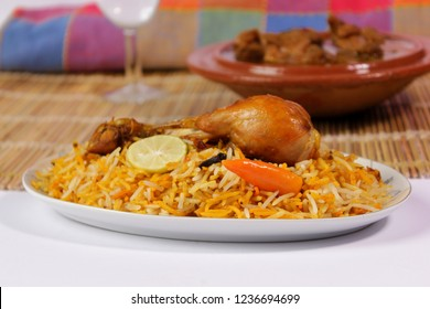 Chicken biryani with qorma, Side view of traditional indian or pakistani food, Spicy fried rice, Ramadan iftar meal, Eid dinner on white background, Christmas party lunch, Delicious diwali treat.