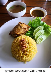 Chicken Biryani with soup and sauce