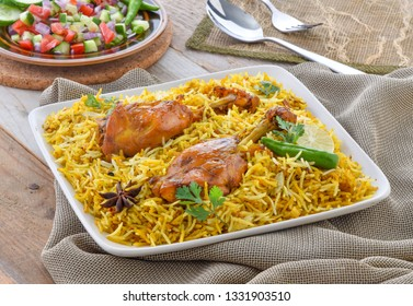 Chicken Biryani, spicy, delicious and mouth-watering rice meal with juicy and tender chicken