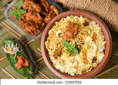 Chicken biryani/Hyderabadi Biriyani/ fried rice and chilli chicken curry, Kerala India. Popular traditional dish/food made using basmati/saffron/jasmine rice, various other exotic Indian spices/masala