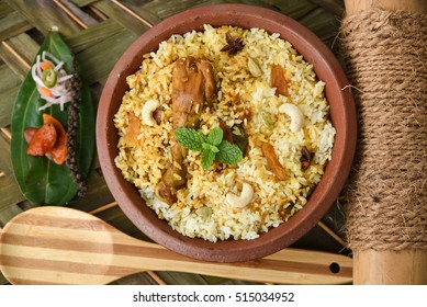 Chicken biryani/Hyderabadi Biriyani, Kerala India. Popular traditional dish/food  made using basmati/saffron/jasmine rice, various other exotic Indian spices/masala. served with pickle, salad, pappad.