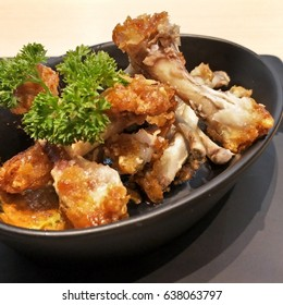 Chicken Bones in black bowl