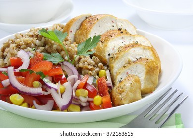 Chicken breast, buckwheat and salad with paprika, onions and corn