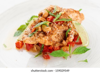Chicken breast cooked in asian style in plate, close-up