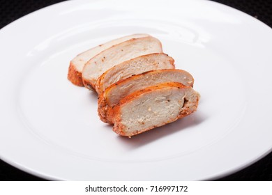 Chicken breast, cooked chicken on a white disk