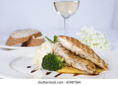 Chicken breast fillet meal with bread and wine