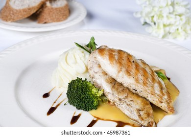Chicken breast fillet meal on a white plate