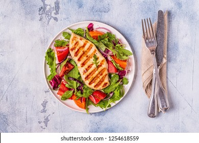 Chicken breast with fresh salad, top view.
