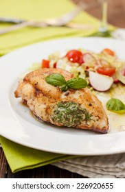 chicken breast with green sauce, vegetables and couscous