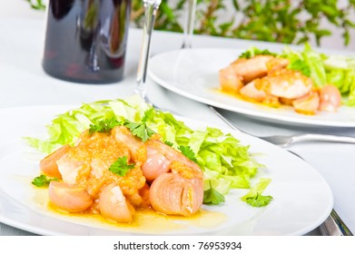 Chicken breast with onion vinaigrette and salad.