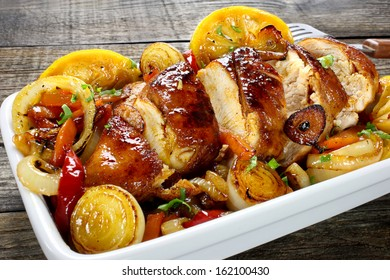 Chicken breast with onions, carrots, paprika, garlic and lemon