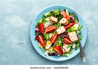 chicken breast salad with fresh vegetables top view and space for a text