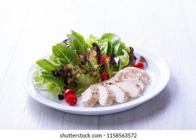 Chicken breast salad on a white plate