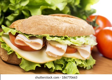 chicken breast sandwich with salad, cheese and tomatoes