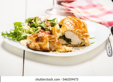 chicken breast stuffed spinach in puff pastry with lettuce mix
