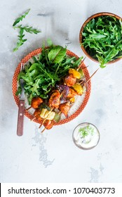Chicken breast vegetable skewers with arugula salad. Healthy eating concept
