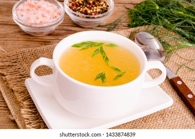 Chicken broth soup in white plate. Studio Photo