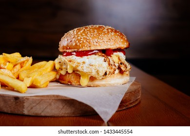 Chicken burger burger with fried egg and fries