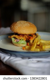 Chicken Burger with Spicy Gochujang Sauce. Close Up