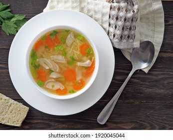 Chicken carcass soup on wooden table