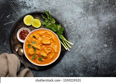 Chicken and cashew red curry, thai inspired dish overhead view with copy space