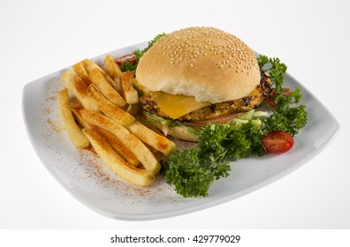 A chicken and cheese burger with seasoned French Fries.