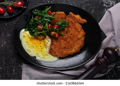 chicken chop with scrambled eggs and fresh salad