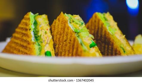 Chicken club sandwich with chips. - Shutterstock ID 1367402045