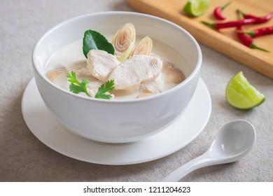 Chicken with coconut milk soup in white bowl, Thai food (Tom Kha Kai)