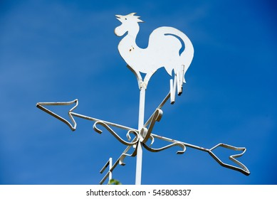 chicken compass with blue sky