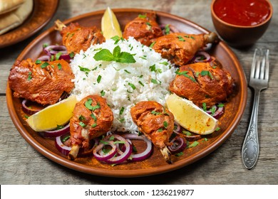 Chicken cooked in a Tandoori oven with basmati rice