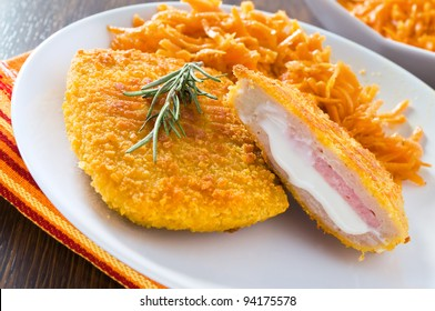 Chicken cordon bleu with grated carrots.