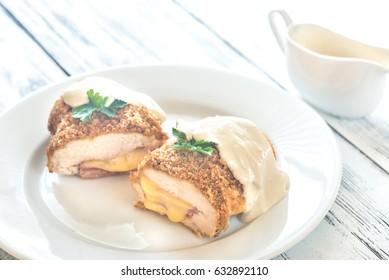 Chicken Cordon bleu on the white plate