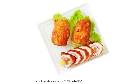 Chicken cordon bleu schnitzel, meat wrapped around ham and cheese, breaded and fried on white porcelain platter isolated