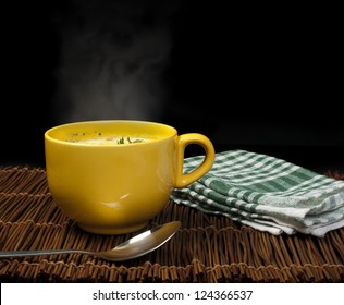 Chicken Cream steaming Soup. Spoon on the table