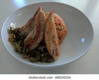 Chicken with Creamy Couscous and Olive-Raisin Sauce