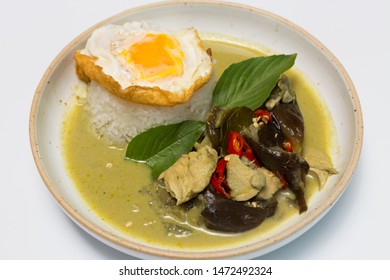 Chicken curry or green curry with steamed rice, served with fried egg. thai style