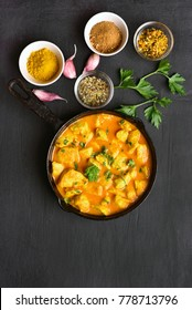 Chicken curry on dark stone background with copy space. Top view, flat lay food