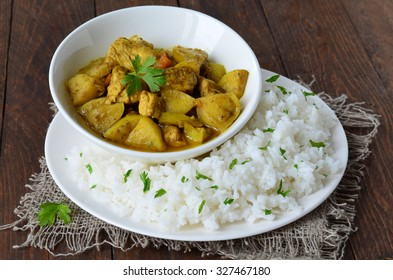 Chicken Curry with Rice on the Plate, Indian Cuisine, selective focus