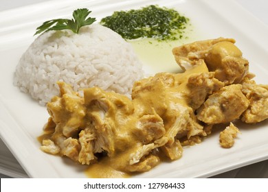 Chicken with curry sauce, served with plain rice