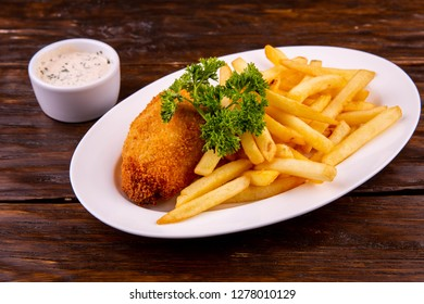 Chicken cutlet breaded with French fries with cheese sauce